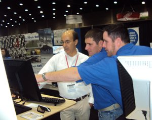 Chris Showing Booth Visitors How Go iLawn works!